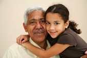 image of extended family  - Child with her grandfather hugging and smiling - JPG