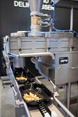 COLOGNE, GERMANY - MARCH 27 : New dosing machine SD for trend food on display at the Leonhardt booth