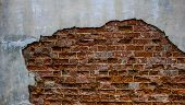 Texture Of Old Red Brick Wall. Grunge Background Brick Wall. Painted Rough Wall Surface. Shabby Buil poster