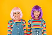 Anime Convention. Happy Little Girls. Anime Fan. Cheerful Friends In Colorful Wigs. Anime Cosplay Pa poster