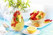 stock photo of iced-tea  - Delicious fresh fruits served in melon bowl as dessert with lemonade - JPG