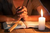Close Up Of Christian Boys  Are Reading And Study Bible In The Room And Lit Candles To Light, Religi poster
