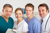 stock photo of medical staff  - Portrait American medical team on hospital ward - JPG