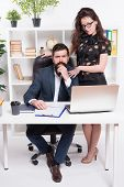 Running Startup Business Together. Confident Businessman And Sexy Woman Working In Startup Company.  poster