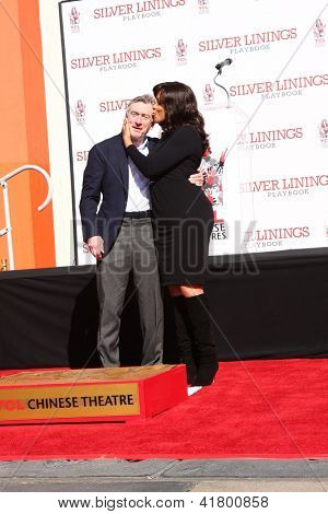 LOS ANGELES - FEB 4:  Robert DeNiro, Grace Hightower at the Robert DeNiro Handprint & Footprint Ceremony  at the TCL Chinese Theater forcourt on February 4, 2013 in Los Angeles, CA