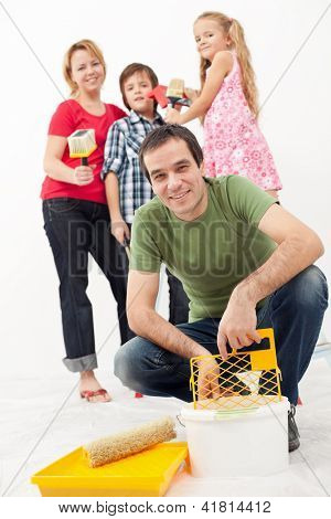 Family redecorating together - painting their home