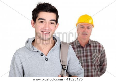 Young man standing next to an experienced worker