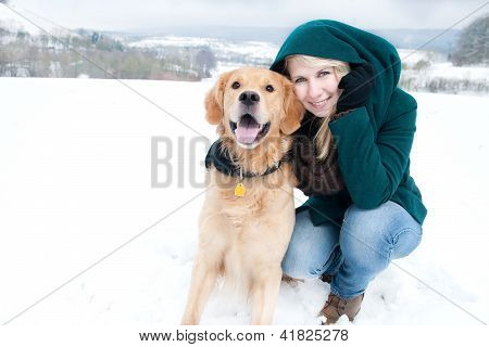 young girl with a golden retriever