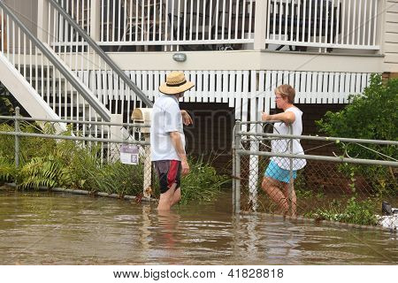 Brisbane, Australia - January 28 : Unidentified Residents Chat In Flood Waters From Ex Tropical Cycl