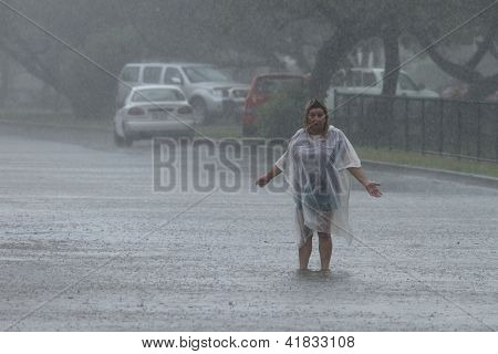 Brisbane, Australia - January 27 : Unidentified Woman Sings In The Rain During Ex Tropical Cyclone O