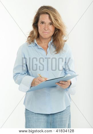 Serious woman filing a form