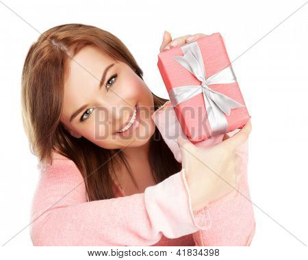 Picture of a happy young adult girl with gift box, cheerful female isolated on white background, pretty woman portrait with romantic present, holiday celebrations concept