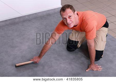 Man fitting a linoleum floor