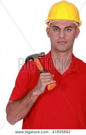 Serious handyman holding hammer
