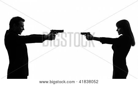 one caucasian couple woman man in duel   in silhouette studio isolated on white background
