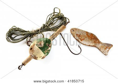 Vintage fishing line with floater, sinker and rusted hook, isolated on white.