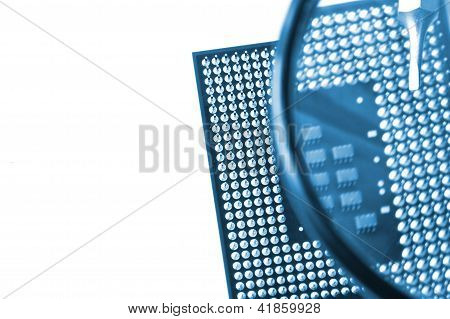 Circuit board under a magnify glass isolated on white