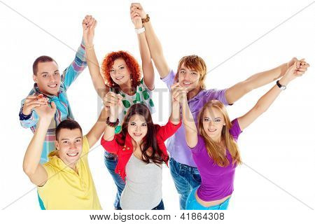 Group of young people standing together and holding hands. Friendship. Isolated over white.