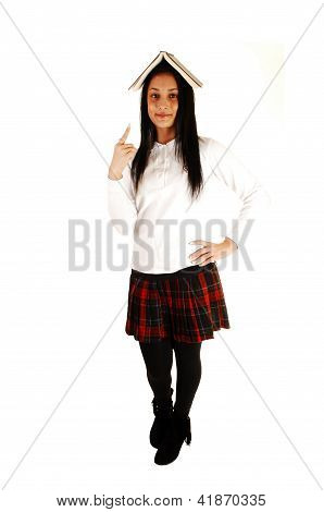 School Girl With Book On Head.