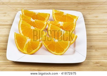 Sliced Fresh Oranges On White Plate