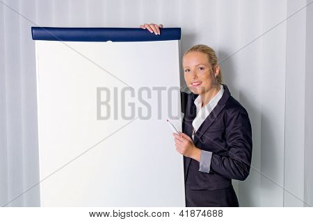 a young woman with a flip chart board during a presentation. training and adult education.
