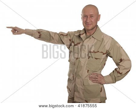 Marine in camouflage standing on a white background