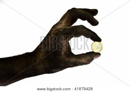 Dirty Hand Holding One Euro Coin.