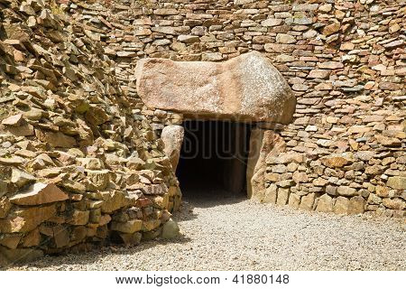 Entrance to the megalithic tomb of La Hougue Bie with Chapel on Jersey, UK