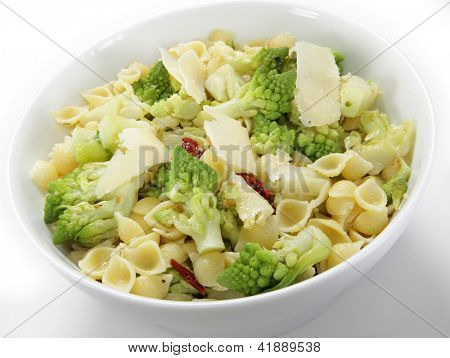 An Italian-style romanesco and pasta meal, cooked with chopped sun-dried tomatoes and topped with slivers of parmesan cheese. The romanescu fllorets are parboiled then fried