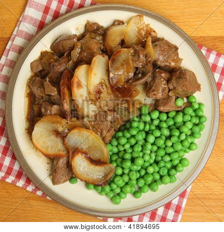 Lancashire hotpot. Traditional English dinner with lamb, kidney and potatoes.