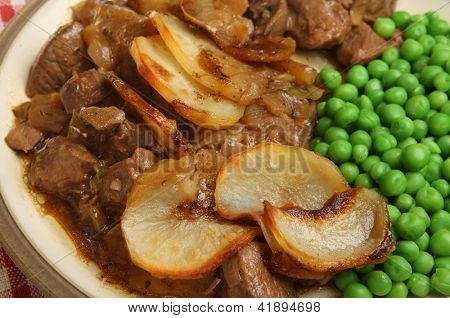 Lancashire hotpot meal with lamb, lambs kidney, onions and potatoes.