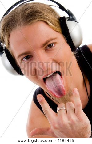 Close Up Of Man Listing Music And Showing Tongue