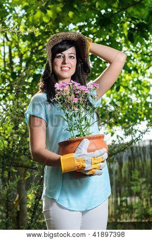 Woman Holding A Flowerpot