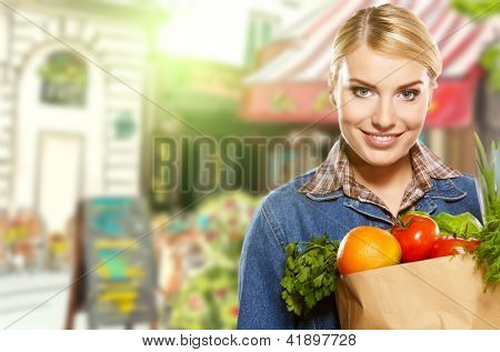 Woman buying some vegetables