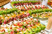 stock photo of canapes  - Trays with various delicious appetizer close up - JPG