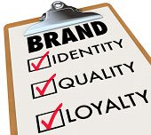 The word brand and its core characteristics such as Identity, Quality and Loyalty written on a check