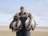 foto of pintail  - Duck hunter after a successfull morning of duck hunting - JPG