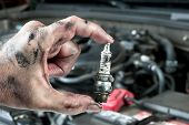 picture of greased  - An auto mechanic holds an old - JPG