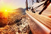 stock photo of yacht  - Yacht Sailing against sunset - JPG