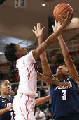 JAMAICA-FEB 2: St. John's Red Storm guard Aliyyah Handford (3) is defended by Connecticut Huskies fo