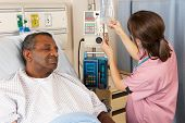image of ward  - Nurse Checking Senior Male Patient - JPG