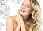 foto of long nails  - portrait of attractive  caucasian smiling woman blond isolated on white studio shot  toothy smile face long hair blond head and shoulders hands nails flowers - JPG