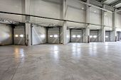 foto of loading dock  - Loading warehouse deck with big cargo doors - JPG
