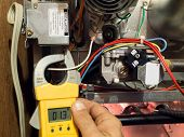 stock photo of voltage  - Various air conditioning and heating technician maintenance
