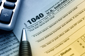stock photo of cpa  - US tax form 1040 with pen and calculator - JPG