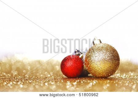 Closeup of Christmas balls on shiny golden background