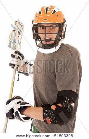 Intense Male Lacrosse Player With Helmet And Stick