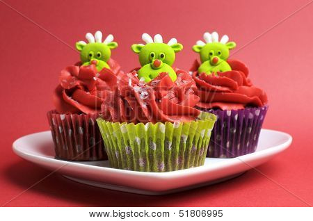 Christmas Cupcakes With Fun And Quirky Reindeer Face Toppings In Modern And Fun Festive Red And Lime