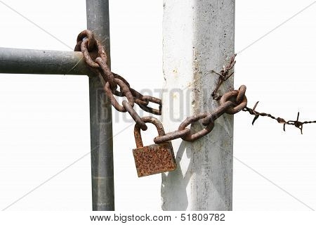 Padlock With An Iron Chain At Fence