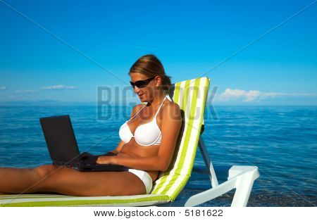 Sexy Beautiful Woman In Bikini Using Laptop